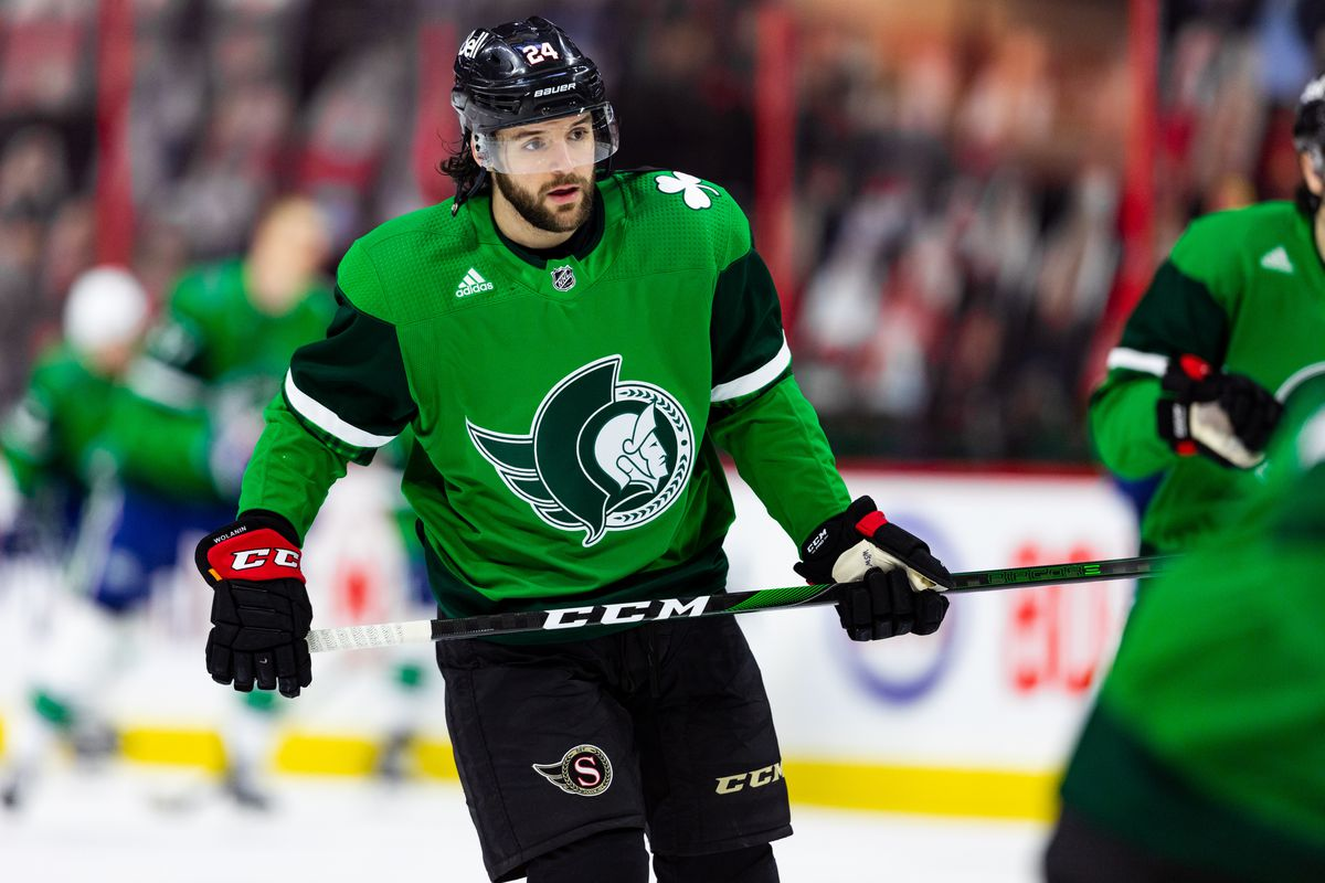 Ottawa Senators Defenceman Christian Wolanin (24) in special St. Patrick's Day jersey during warm-up before National Hockey League action between the Vancouver Canucks and Ottawa Senators on March 17, 2021, at Canadian Tire Centre in Ottawa, ON, Canada.