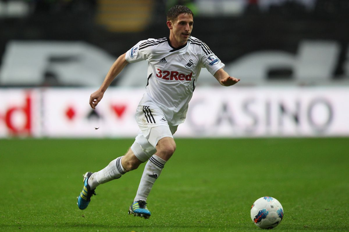 SWANSEA, WALES - OCTOBER 29:  Joe Allen of Swansea City during the Barclays Premier League match between Swansea City and Bolton Wanderers at the Liberty Stadium on October 29, 2011 in Swansea, Wales.  (Photo by Michael Steele/Getty Images)