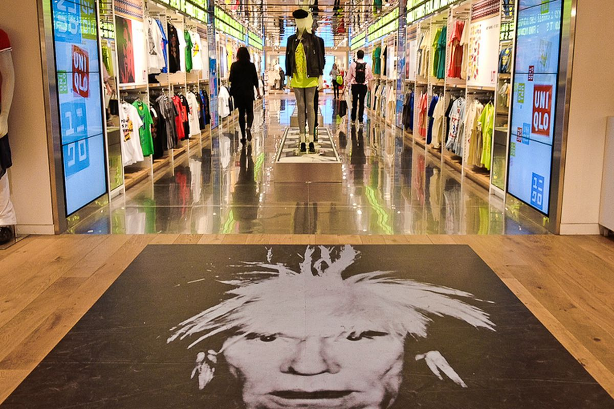 """Uniqlo on Fifth Avenue in NYC. Image via <a href=""""http://ny.racked.com/archives/2012/03/29/uniqlos_newest_stunt_free_cds_on_jazz_thursdays.php"""">Racked NY</a>."""