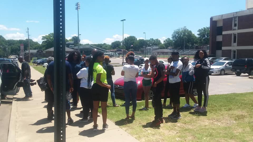 Friends and former classmates of Brandon Webber gather on Thursday at Central High School, his alma mater.