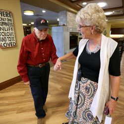 Terri Kinney, assisted living director and nurse, leads Alzheimer patient David Dowdle to Bible study at Sagewood at Daybreak Assisted Living in South Jordan on Tuesday, Aug. 9, 2016.