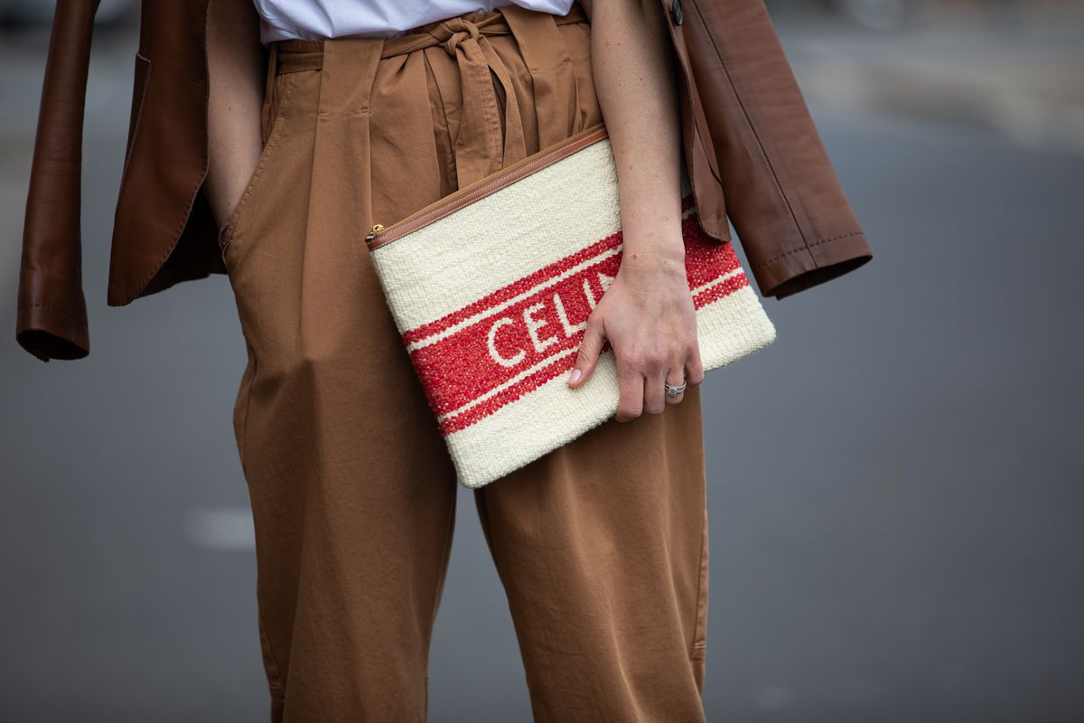 A woman wearing brown cargo pants.