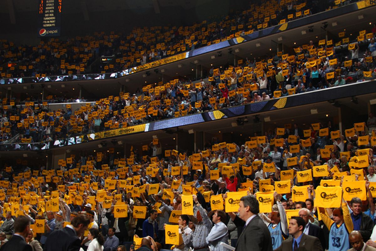Memphis Grizzlies fans raise their growl towels during an NBA game at the FedEx Forum on April 25, 2013.