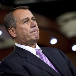 Speaker of the House John Boehner of Ohio pauses at a news conference to announce an agreement for a 2-month extension to the payroll tax cut on Capitol Hill Thursday, Dec. 22, 2011, in Washington.