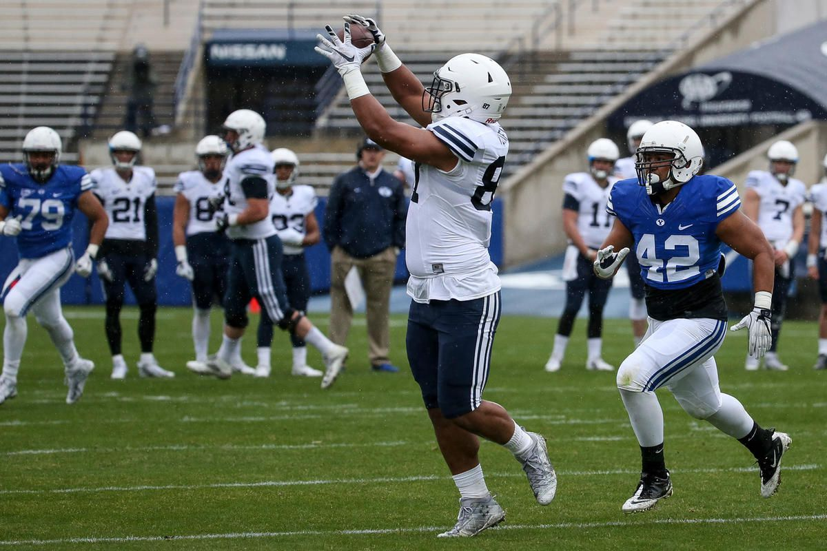 Tight end Joe Tukuafu snags a pass during the BYU football spring practice and scrimmage at LaVell Edwards Stadium in Provo on Saturday, March 25, 2017.