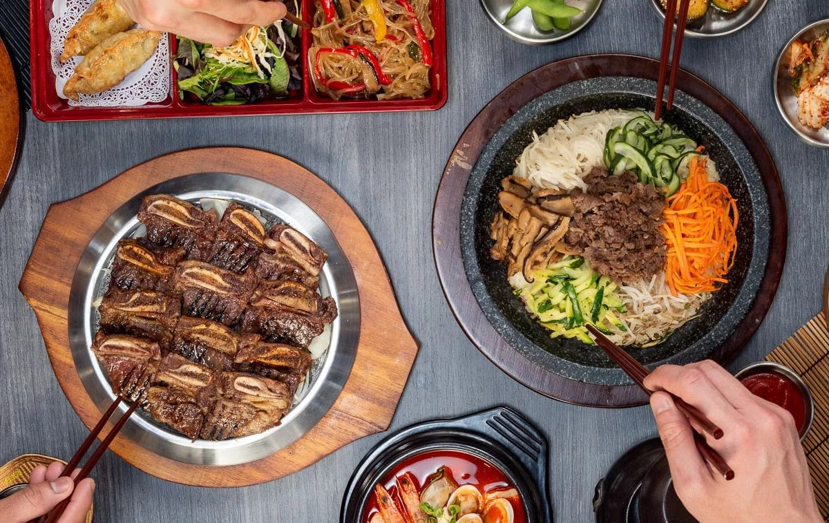 A variety of Korean dishes spread out on a table.