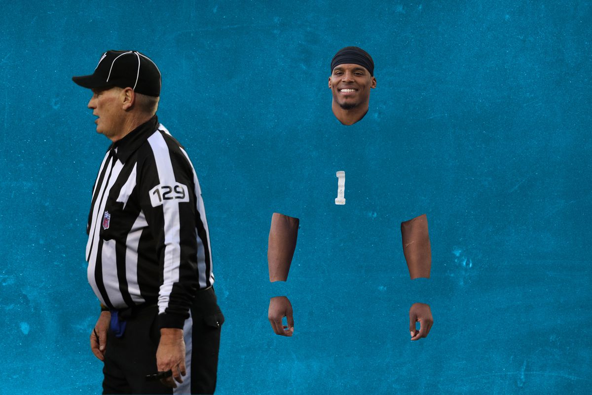 A player camouflaged into the blue background standing next to a referee looking the other way