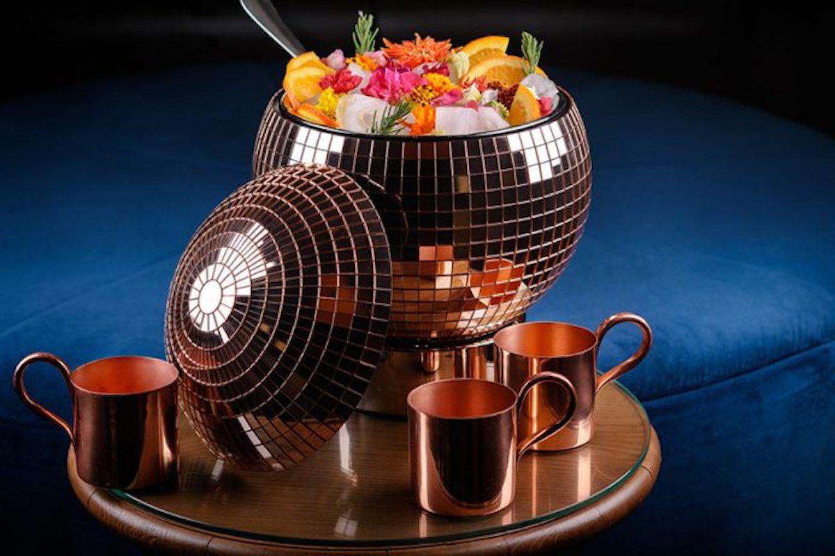 A disco ball punch bowl