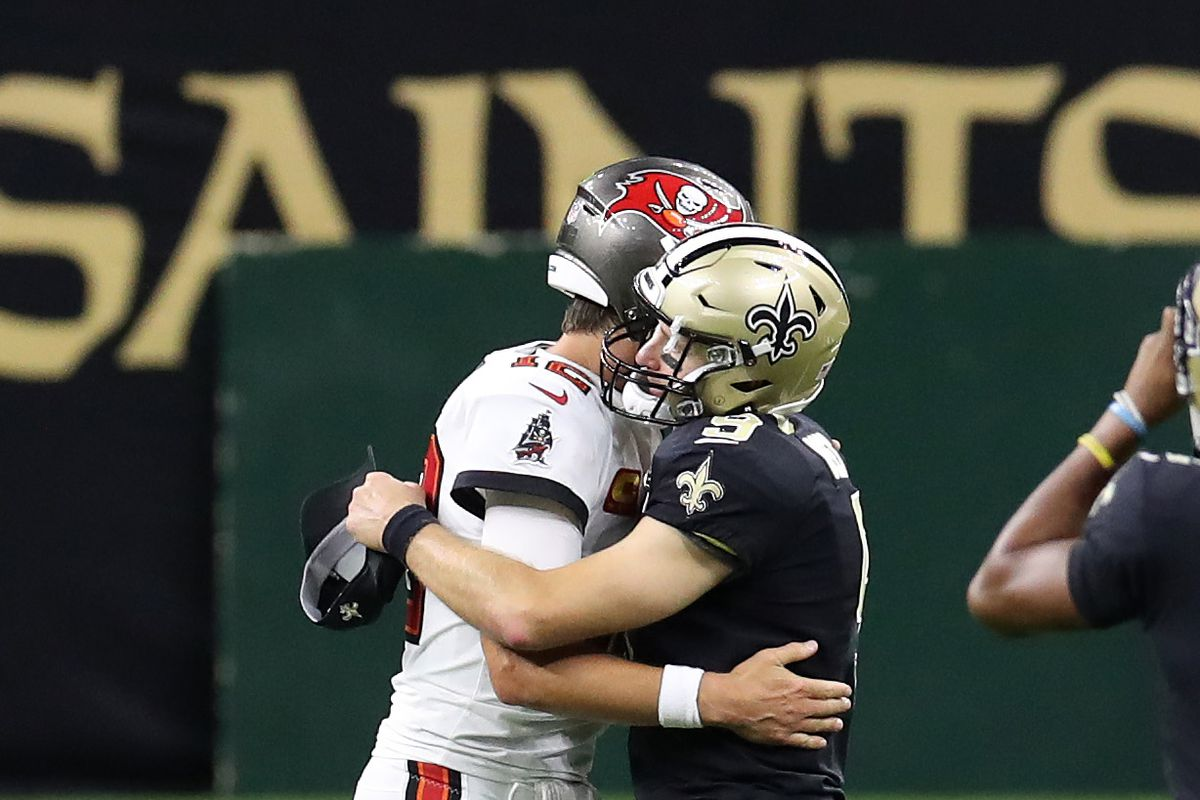 Tom Brady of the Tampa Bay Buccaneers hugs Drew Brees of the New Orleans Saints following a game at the Mercedes-Benz Superdome on September 13, 2020 in New Orleans, Louisiana.