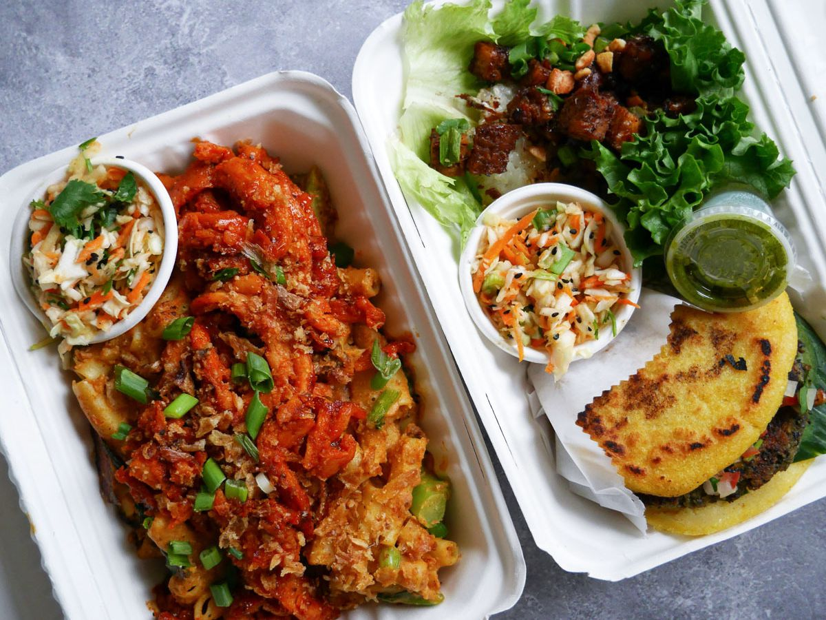 A photo of the mac and cheese, falafel arepa, and tempeh lettuce wrap from Planted