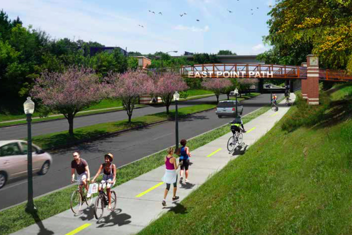 In renderings, a proposed multi-use path and pedestrian bridge connecting downtown East Point to Tri-Cities High School.