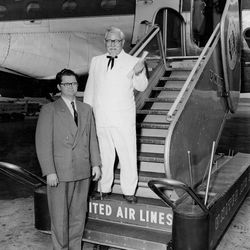 Pete Harman, left, with Col. Sanders, of Kentucky Fried Chicken fame, are pictured at the Salt Lake International Airport in June 4 of 1954.