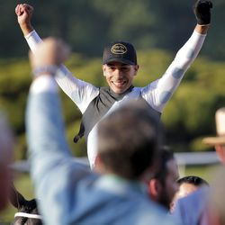 Jose Ortiz celebrates after riding Tapwrit to victory in the 149th running of the Belmont Stakes horse race, Saturday, June 10, 2017, in Elmont, N.Y.