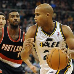 Utah Jazz small forward Richard Jefferson (24) drives around the defense of Portland Trail Blazers small forward Dorell Wright (1) in the second half of a game at the Energy Solutions Arena on Wednesday, October 16, 2013.