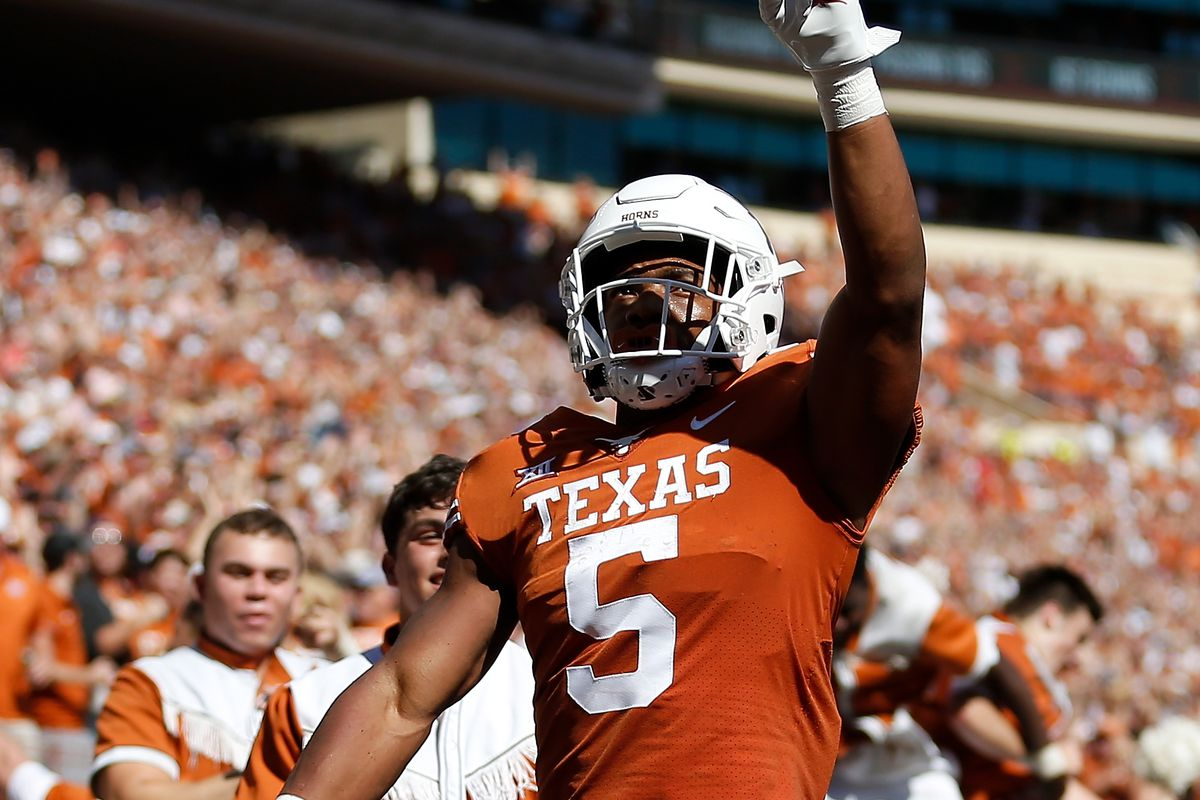 Bijan Robinson of the Texas Longhorns reacts after a touchdown reception in the first quarter against the Texas Tech Red Raiders at Darrell K Royal-Texas Memorial Stadium on September 25, 2021 in Austin, Texas.