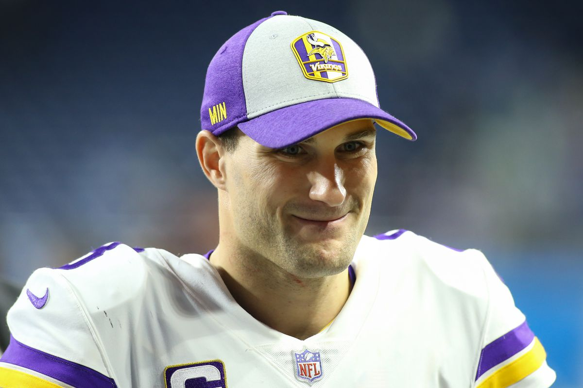 Minnesota Vikings quarterback Kirk Cousins smiles as walks off of the field at the conclusion of a regular season game between the Minnesota Vikings and the Detroit Lions on December 23, 2018 at Ford Field in Detroit, Michigan.