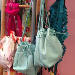 Leather drawstring bags, $53
