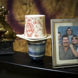 A family photo and other items sit atop a TV in a destruction room at Tantrums in Houston on Saturday, July 15, 2017. Tantrums is a business where people can let off steam by using bats, poles, golf clubs and sledge hammers to destroy TVs, mirrors, cups, sheets of glass and more. The owner, Shawn Baker, started Tantrums after she was laid off from her job in the oil industry, and she said her business acts as therapy to some and fun for others.