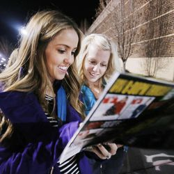 Hollie Bryant and Jacee Chrestensen look at an ad as they join hundreds Thursday, Nov. 28, 2013 at Kohl's in American Fork, Utah,  for an early Black Friday opening.