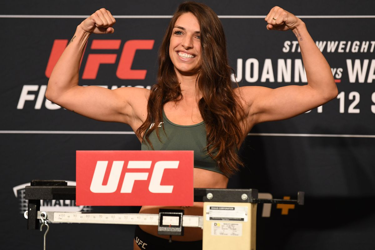 Mackenzie Dern poses on the scale during the UFC Fight Night weigh-in at the Westin Tampa Waterside on October 11, 2019 in Tampa, Florida.