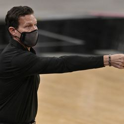 Utah Jazz head coach Quin Snyder gestures to his players during the first half of an NBA basketball game against the San Antonio Spurs, Sunday, Jan. 3, 2021, in San Antonio.