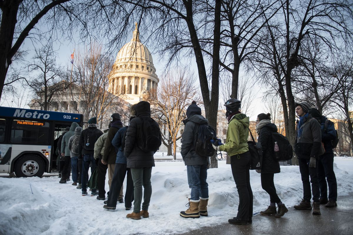 Commuters wait for the bus on South Pinckney Street in downtown Madison, Wis. as extreme temperatures hit the region. Jan. 29, 2019.
