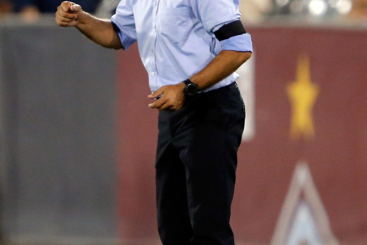 COMMERCE CITY, CO - AUGUST 04:  Head coach Oscar Pareja contemplates the meaning of existential nihilism. (Photo by Doug Pensinger/Getty Images)