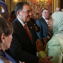 Gov. Gary Herbert speaks to members of the audience after signing signing a concurrent resolution affirming Utah's support for the religious and civil liberties of immigrants and refugees during a ceremony at the Capitol in Salt Lake City on Monday, April 17, 2017.