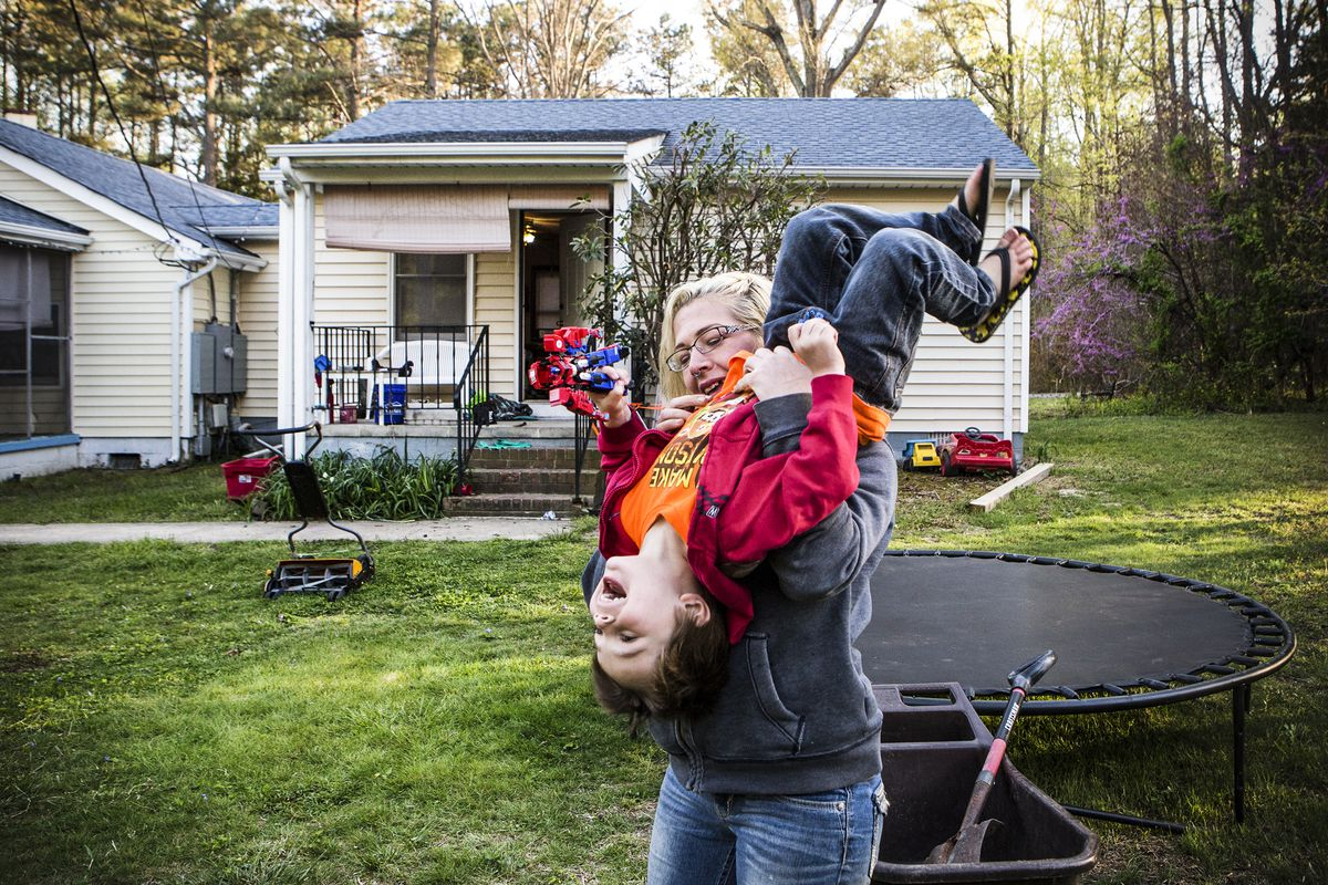 Fawn Ricciuti, 33, plays with her son Aiden, 5, in the yard of her House outside Richmond, Virginia.