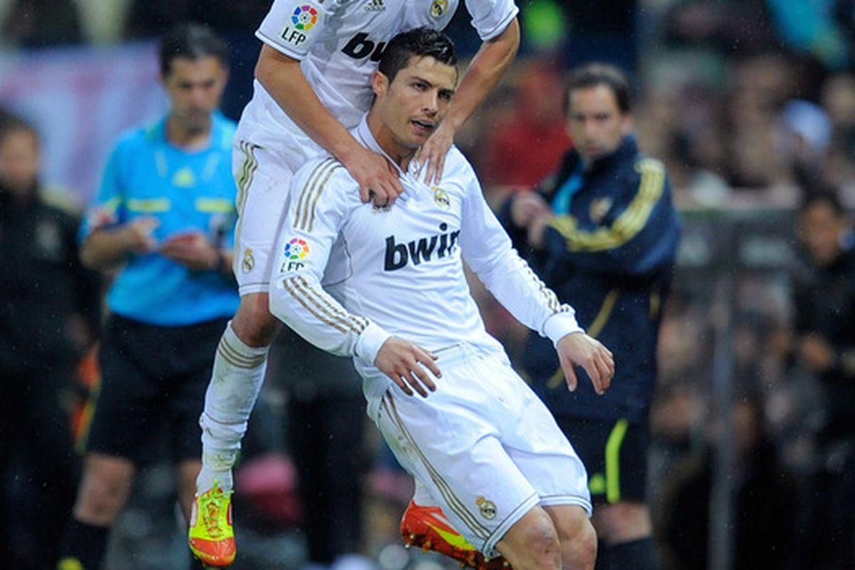 Cristiano Ronaldo of Real Madrid celebrates with Fabio Coentrao after scoring Real's opening goal.