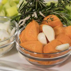 Garlic, leeks and carrots will add flavor to the pot roast.   Ashlee Rezin/Sun-Times