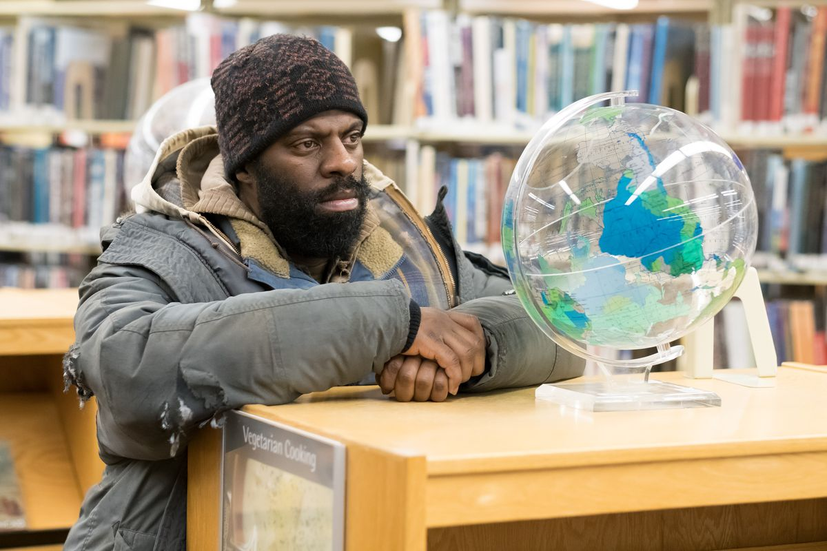 """Chicago-based hip-hop artist and philanthropist Che """"Rhymefest"""" Smith plays Big George, a homeless man, in """"The Public.""""   Greenwich Entertainment"""