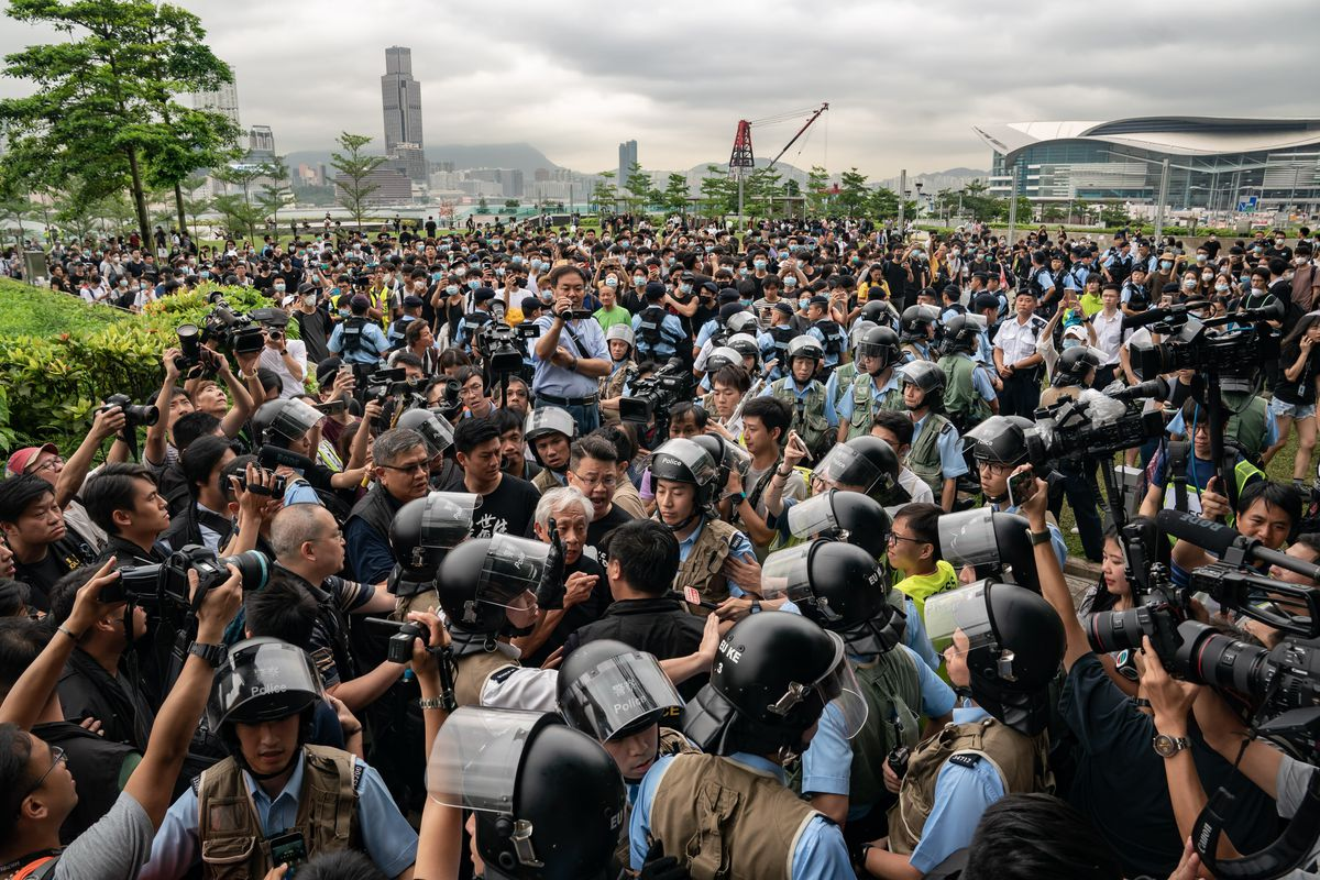 Protesters clash with police officers in Hong Kong.