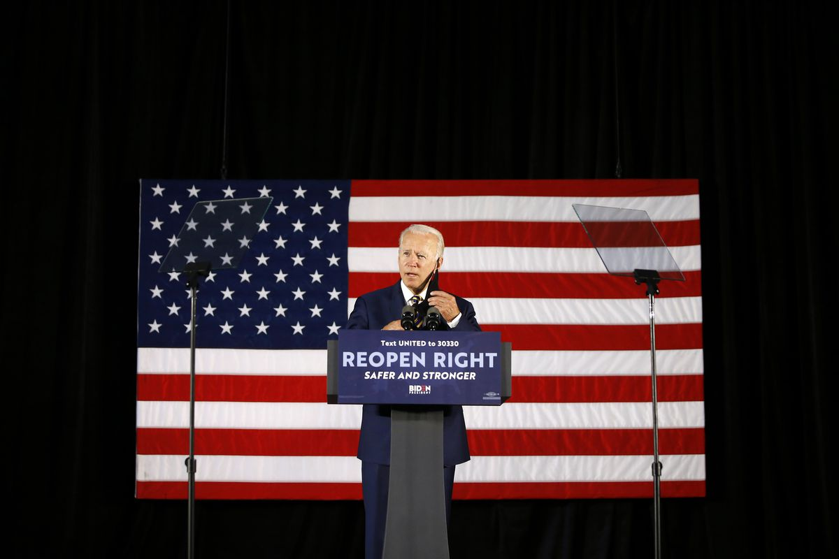 Democratic presidential candidate former Vice President Joe Biden removes his mask while speaking in Darby, Pa., last week.