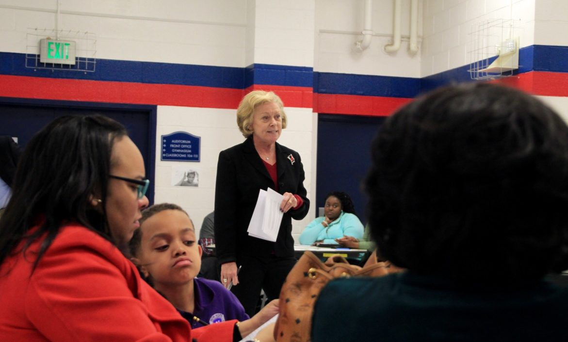 Interim ASD Superintendent Kathleen Airhart announces the proposed change during a community meeting.