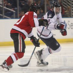 UConn's Tage Thompson (29) tries to beat  Northeastern's Nolan Stevens (21) to the puck off of the opening face-off.
