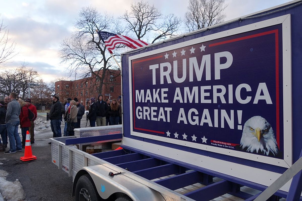 People line up to attend a Donald Trump campaign rally raising funds for US military veterans at Drake University in Des Moines, Iowa, on Thursday.