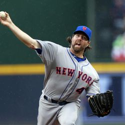 New York Mets starting pitcher R.A. Dickey (43) works in the first inning of a Major League Baseball game against the Atlanta Braves in Atlanta, Wednesday, April 18, 2012.