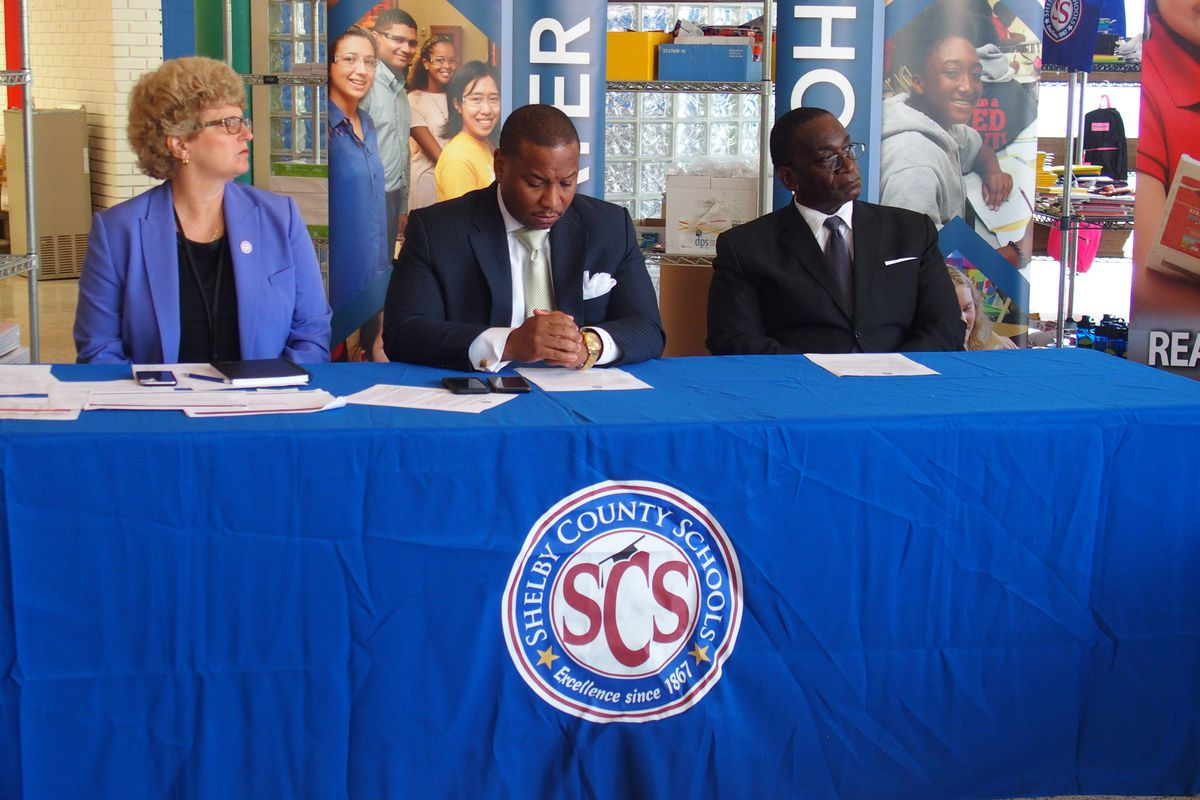 Joris Ray, center, was appointed interim superintendent for Shelby County Schools.