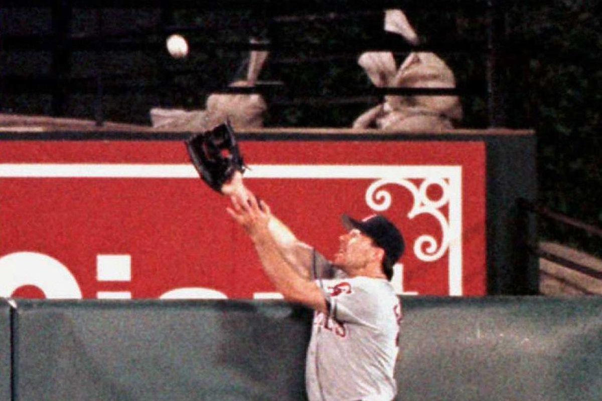 California Angels centerfielder Jim Edmonds reache