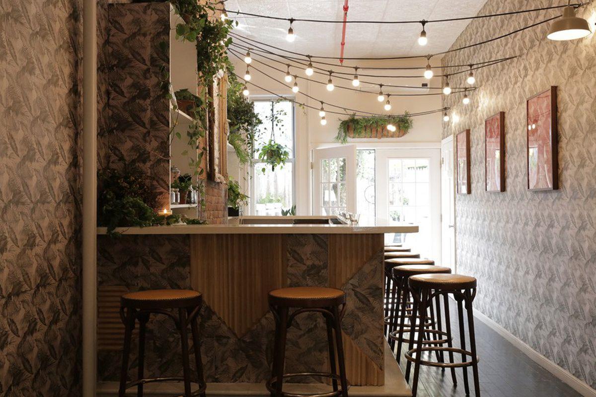"The bar inside Cutler; Image via <a href=""http://www.wwd.com/beauty-industry-news/hair/cutler-salons-expand-to-brooklyn-and-beyond-7935466"">WWD</a>"