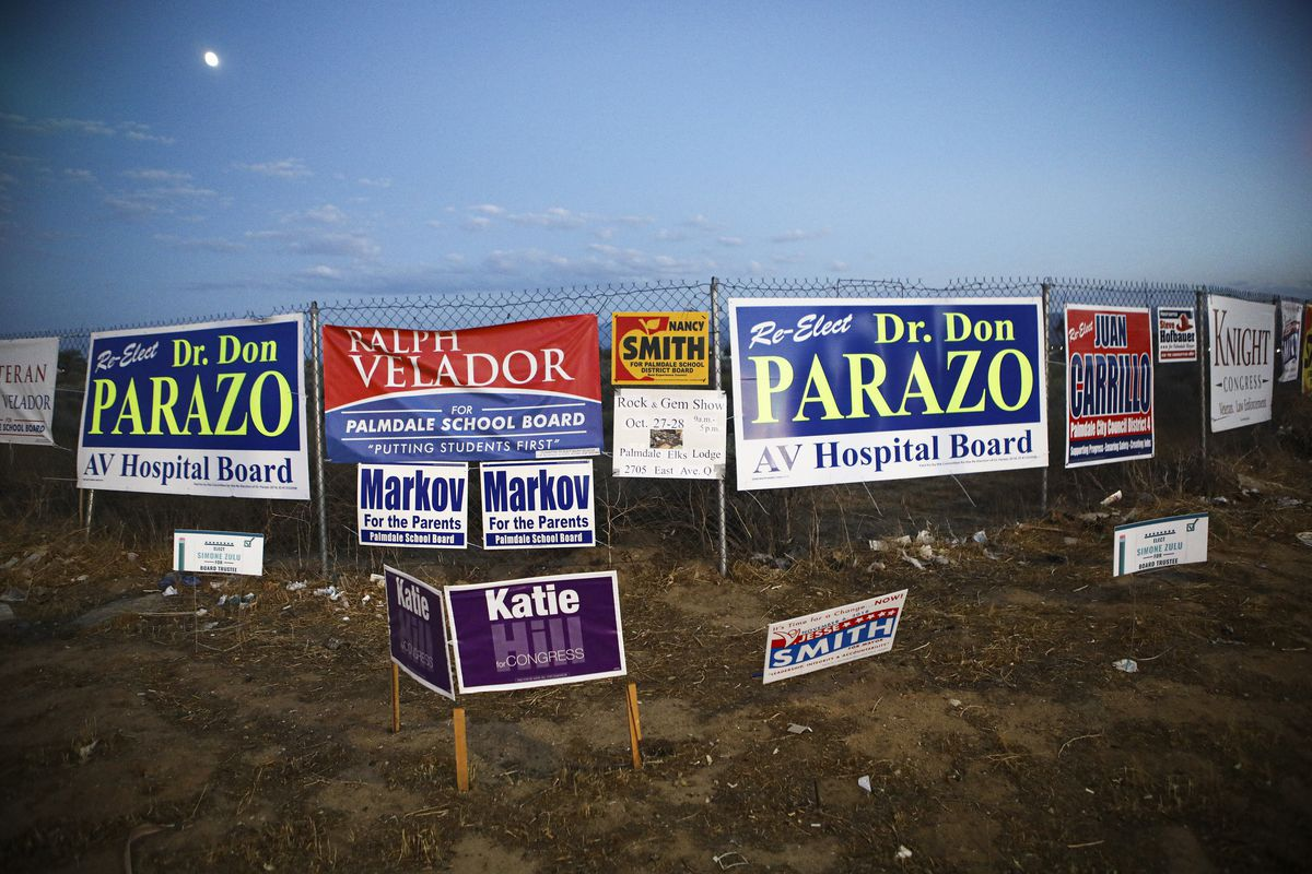 """A """"Katie Hill"""" sign appears among other campaign signs."""