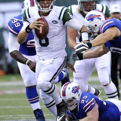 ADVANCE FOR WEEKEND EDITIONS, SEPT. 15-16 - In this photo taken Sept 9, 2012, New York Jets quarterback Mark Sanchez scrambles during the first half of an NFL football game against the Buffalo Bills at MetLife Stadium in East Rutherford, N.J. Sanchez sent a message to his critics with a terrific performance against the Bills that left no doubt: He's the undisputed leader of this team.