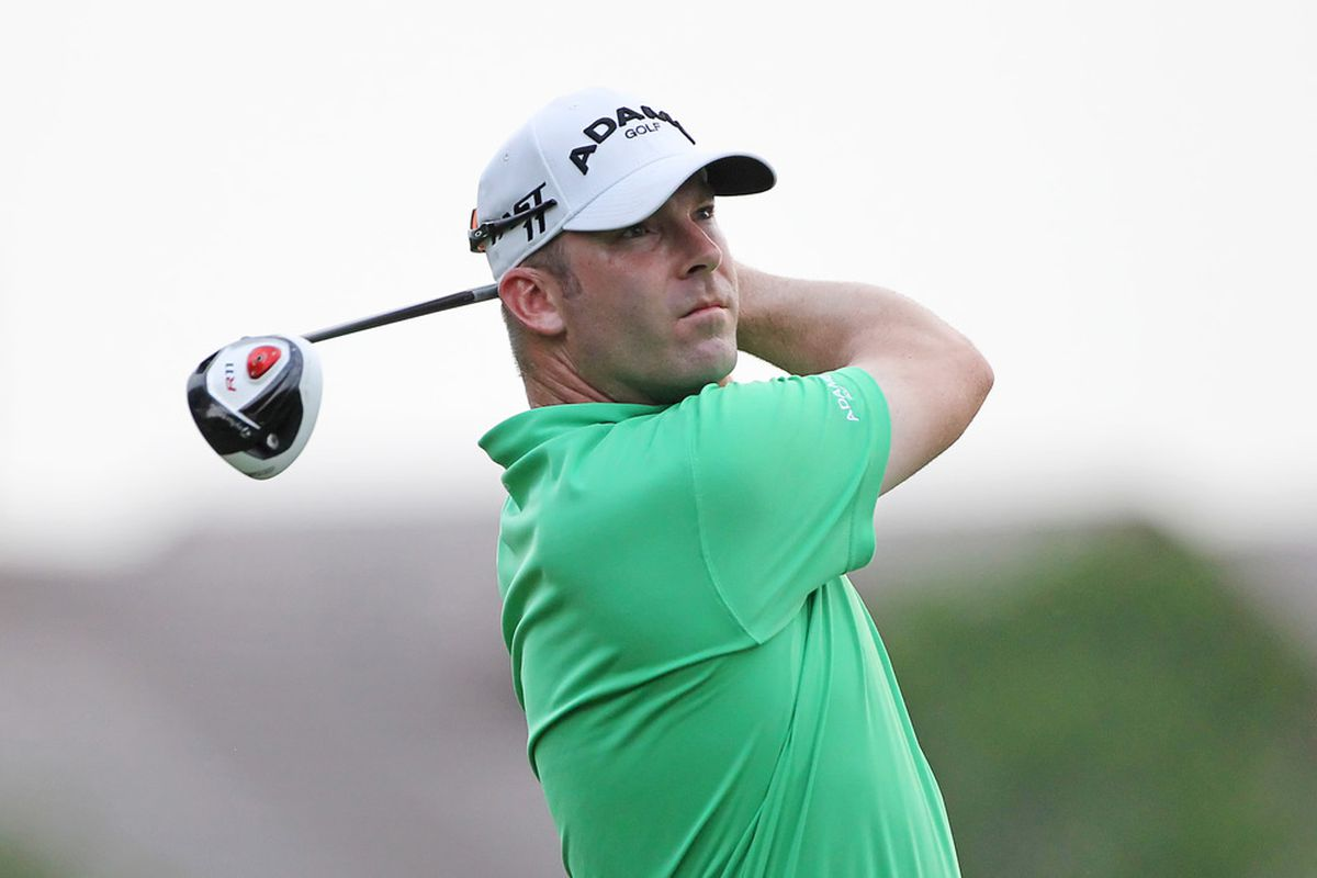 PLANO, TX - MAY 23: Justin Hicks hits his tee shot on the first playoff hole during the Open Qualifying Competition at Gleneagles Country Club on May 23, 2011 in Plano, Texas. (Photo by Hunter Martin/Getty Images)