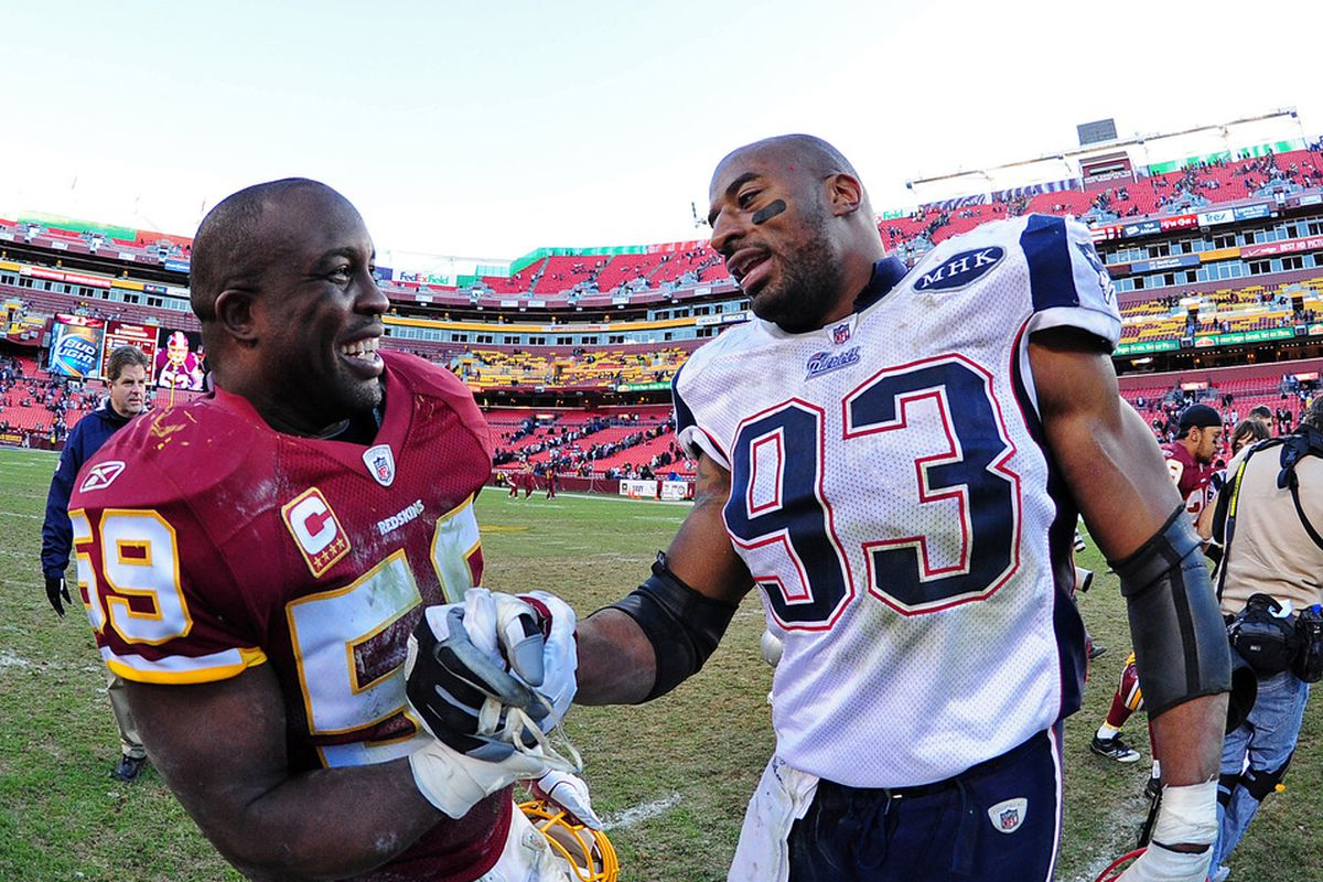 LANDOVER, MD - DECEMBER 11: London Fletcher #59 of the Washington Redskins greets Andre Carter #93 of the New England Patriots after the game at FedEx Field on December 11, 2011 in Landover, Maryland. (Photo by Scott Cunningham/Getty Images)