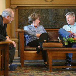 Libertarian presidential candidate Gov. Gary Johnson talks with friends Tom Mahon and Kathy Hunter as he and running mate Gov. Bill Weld pay a visit to Salt Lake City for a speech at the University of Utah on Saturday, Aug. 6, 2016.