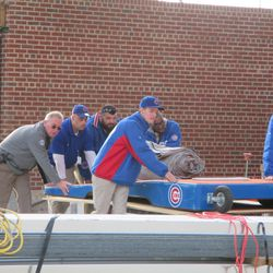6:30 p.m. Cart being pushed away, under the right field bleachers -