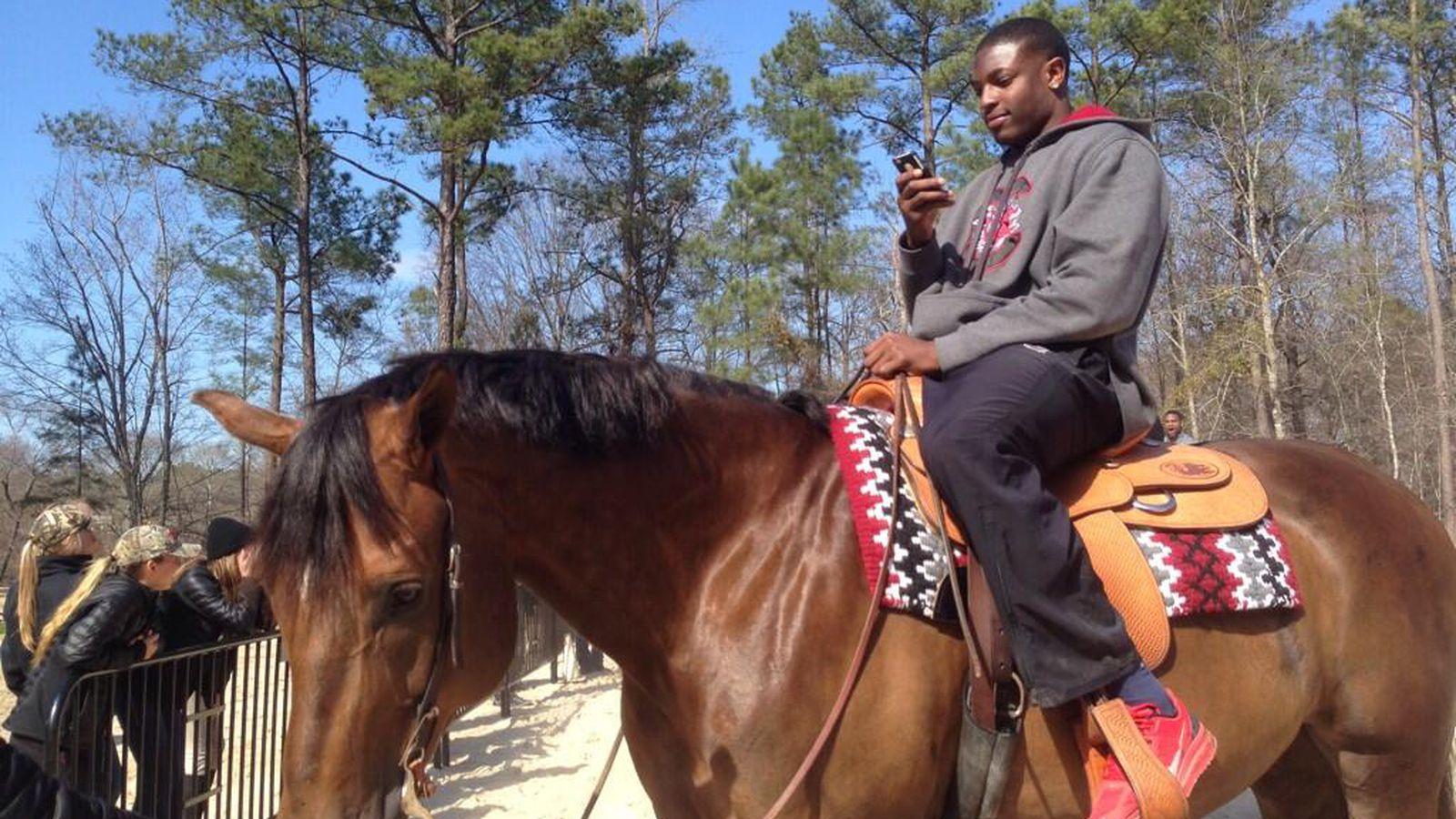 South Carolina Football Players Riding Horses Garnet And