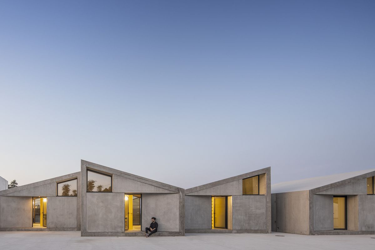 Prefab homes made of concrete modules rise in Portugal - Curbed