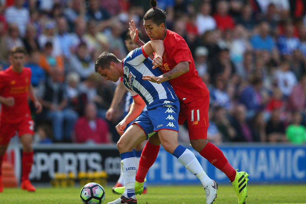 Taylor holding off Liverpool's Firmino in a pre-seaosn friendly